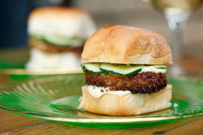 Crab-cake sliders with cucumber and aioli.