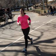 A woman goes for a jog in Central Park on March 11, 2014 in New York City. After an unusually frigid winter, temperatures are supposed to reach into the 60s today.