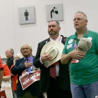 Delegates stand at attention during the national anthem during the Texas Republican Convention Friday, May 13, 2016, in Dallas. (AP Photo/LM Otero)