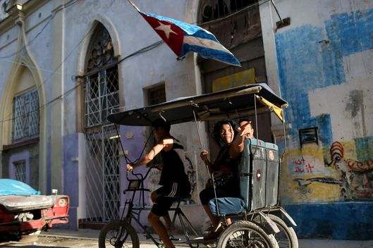 HAVANA, CUBA - FEBRUARY 23: A pedicycle drives through the streets of Old Havana on February 23, 2015 in Havana, Cuba.  The recent thaw in U.S.-Cuba relations has increased the number of American visitors to the island.  (Photo by Joe Raedle/Getty Images)