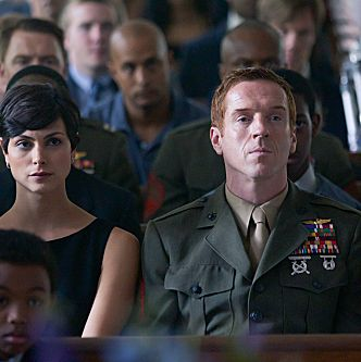 Morena Baccarin as Jessica Brody and Damien Lewis as Nicholas