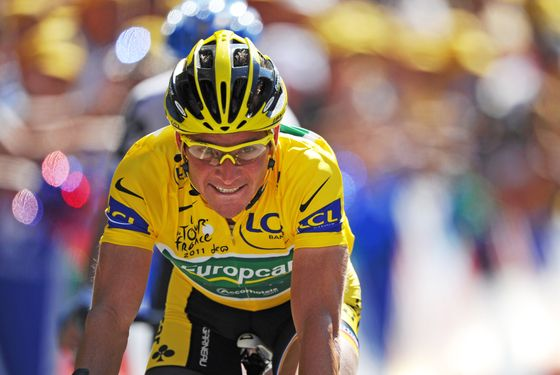 Yellow jersey of overall leader, France's Thomas Voeckler,  ends riding on the finish line their 179 km and seventeenth stage of the 2011 Tour de France cycling race run between Gap and Pinerolo (Italy) on July 20, 2011.  AFP PHOTO / PASCAL PAVANI (Photo credit should read PASCAL PAVANI/AFP/Getty Images)