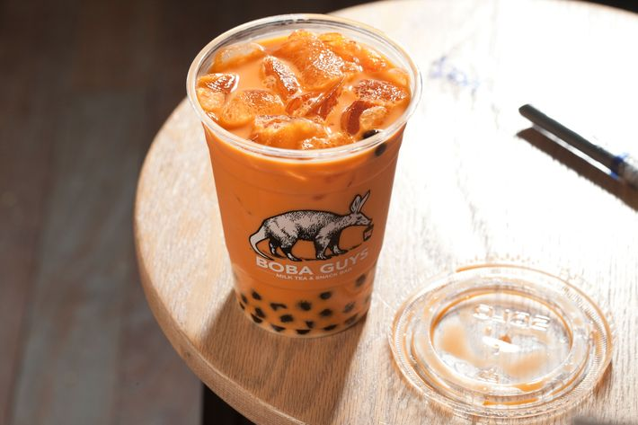 Thai iced tea with boba.