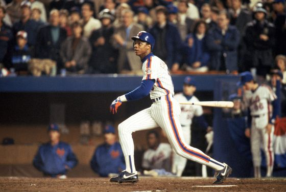 FLUSHING, NY - OCTOBER 27:  Right fielder Darryl Strawberry #18 of the New York Mets swings during game 7 of the 1986 World Series against the Boston Red Sox at Shea Stadium on October 27, 1986 in Flushing, New York. The Mets won the series 4-3.  (Photo by T.G. Higgins/Getty Images)