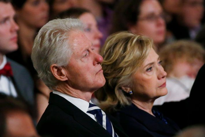 """NEW YORK, NY - MAY 15:  (L-R) Former U.S. president Bill Clinton and former U.S. Secretary of State Hillary Clinton attend the opening ceremony for the National September 11 Memorial Museum at ground zero May 15, 2014 in New York City. The museum spans seven stories, mostly underground, and contains artifacts from the attack on the World Trade Center Towers on September 11, 2001 that include the 80 ft high tridents, the so-called """"Ground Zero Cross,"""" the destroyed remains of Company 21's New York Fire Department Engine as well as smaller items such as letter that fell from a hijacked plane and posters of missing  loved ones projected onto the wall of the museum. The museum will open to the public on May 21.  (Photo by Mike Segar-Pool/Getty Images)"""