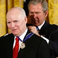 WASHINGTON - NOVEMBER 05:  U.S. President George W. Bush (R) hangs a Presidential Medal of Freedom on the neck of Brian Lamb (L), President and CEO of C-SPAN during a ceremony for the 2007 recipients in the East Room of the White House November 5, 2007 in Washington, DC. The Medal of Freedom is given to those who have made remarkable contributions to the security or national interests of the United States, world peace, culture, or other private or public endeavors.  (Photo by Chip Somodevilla/Getty Images) *** Local Caption *** Brian Lamb;George W. Bush