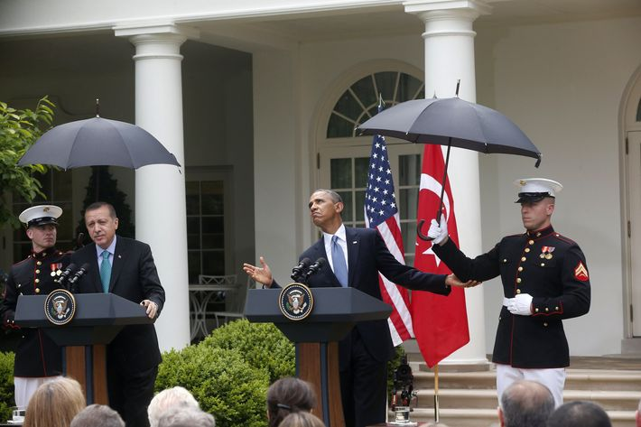 President Barack Obama, accompanied by Turkish Prime Minister Recep Tayyip Erdogan checks for rain during their joint news conference in the Rose Garden of the White House in Washington, Thursday, May 16, 2013. (AP Photo/Charles Dharapak)