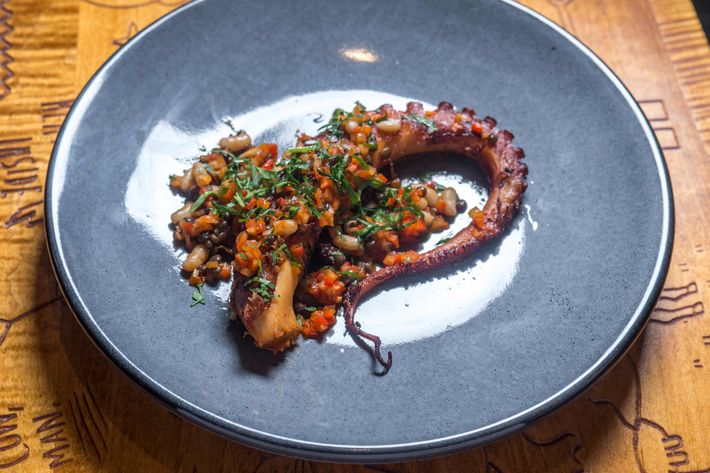 Grilled octopus with rice, beans, and beluga lentils.