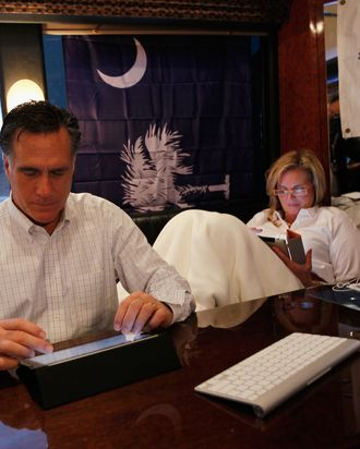 GILBERT, SC - JANUARY 20: Republican presidential candidate, former Massachusetts Gov. Mitt Romney and his wife, Ann Romney, ride on the campaign bus after leaving a stop at Barn, Harmon Tree Farm on January 20, 2012 in Gilbert, South Carolina. Romney continues to campaign for votes in South Carolina ahead of their primary on January 21st. (Photo by Joe Raedle/Getty Images)