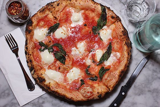 "<b>Margherita</b>    <a href=""http://motorinopizza.com/"">Motorino</a>    <i>New York</i>  When Anthony Mangieri uprooted Una Pizza Napoletana and took it to the West Coast, Belgian-born chef Mathieu Palombino quickly snatched up the East Village property and its highly coveted, made-in-Naples Acunto wood-burning oven for a second location of his immensely popular (now defunct, <a href=""http://newyork.grubstreet.com/2012/09/motorino-reopening-in-brooklyn.html"">but opening again soon</a>) Brooklyn Neapolitan-style pizzeria. As a testament to his Old World pizzaiolo skills, Palombino <a href=""http://newyork.grubstreet.com/2012/11/matthieu-palombino-mtorino-is-batman.html"">kept the fires burning and the pies coming</a> throughout the power outages caused by Superstorm Sandy."