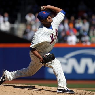 Johan Santana #57 of the New York Mets throws a pitch against the Atlanta Braves during their Opening Day Game at Citi Field on April 5, 2012 in New York City.