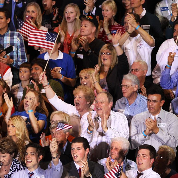The crowd gathered in support of Mitt Romney cheers as the polls close at 8 p.m. EST, on primary night in Florida.