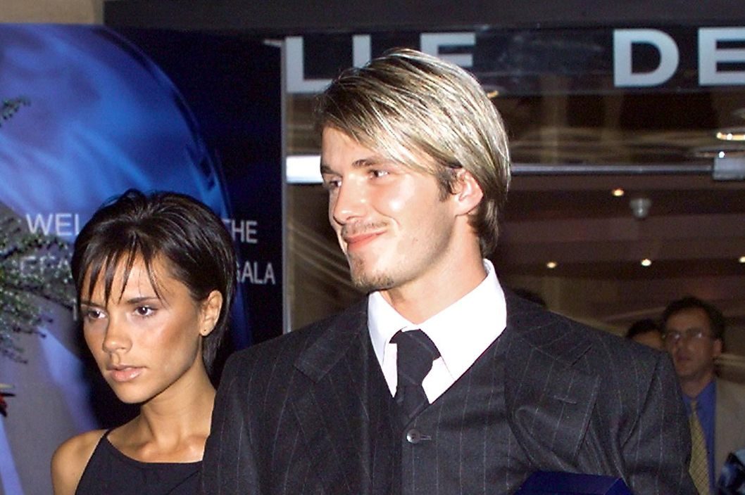 "Manchester United striker David Beckham is accompanied by his wife, former ""Spice Girl "" Victoria Adams, as they leave the Monaco Sporting Club late 26 August 1999 after he was elected Best player of the Year during an UEFA evening gala."