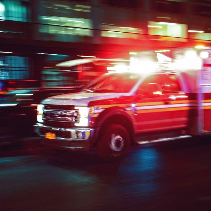 Ambulance speeding at night.