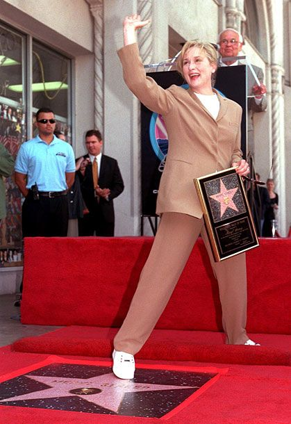 With her star on the Hollywood Walk of Fame.