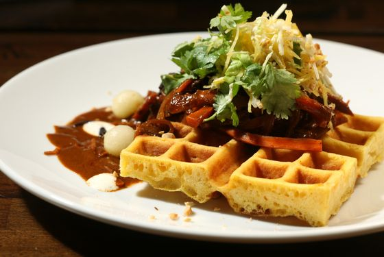 Carrot (pulled, pickled, and jerked carrots with peanut mole sauce on carrot waffles).