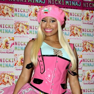LONDON, ENGLAND - APRIL 19: Nicki Minaj signs copies of her number one album 'Pink Friday: Roman Reloaded' at HMV Bayswater on April 19, 2012 in London, England. (Photo by Danny Martindale/Getty Images)