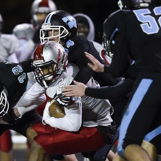 Blair's Daymon Anderson gets tackled by the Whitman offense after making an interception during the last regular season game on Friday, November 7, 2014. Blair defeated Whitman 41-0 and earned a spot in the playoffs.
