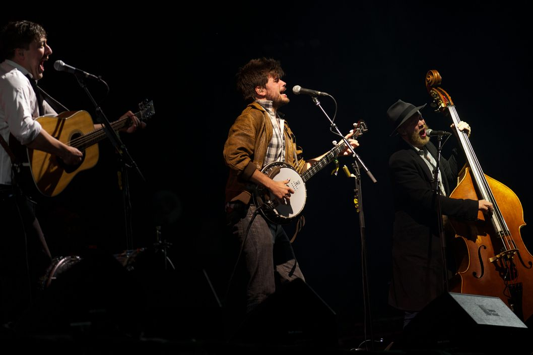 (L to R) British musicians Ben Lovett, Marcus Mumford, Winston Marshall and Ted Dwane  perform with the headline band Mumford and Sons on the Pyramid Stage on the fifth day of the Glastonbury Festival of Contemporary Performing Arts near Glastonbury, southwest England on June 30, 2013. The festival attracts 170,000 party-goers to the dairy farm in Somerset, and this year's tickets sold out within two hours of going on sale. The Rolling Stones will perform at the festival for the first time, headlining on Saturday night. AFP PHOTO/ANDREW COWIE        (Photo credit should read ANDREW COWIE/AFP/Getty Images)