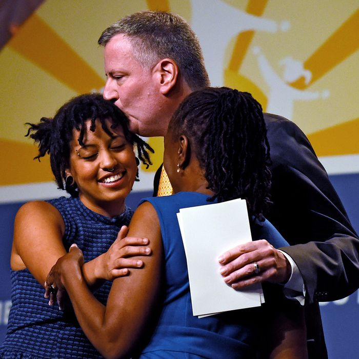 New York City Mayor Bill de Blasio and his wife, Chirlane McCray (R) hug their daughter, Chiara de Blasio (L), before she received a special recognition award at the National Council for Behavioral Health's Annual Conference at the Gaylord National Resort & Convention Center on May 6, 2014 in National Harbor, Maryland. The general session on Children's Mental Health Awareness Day helped bring awareness to mental health issues in young adults and children.