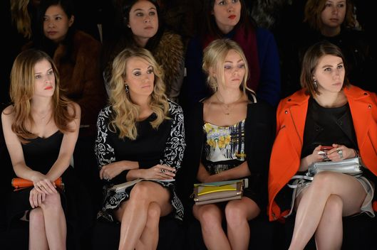 (L-R)Actresses Anna Kendrick, singer Carrie Underwood, AnnaSophia Robb and Zosia Mamet attend Rebecca Minkoff fashion show during Mercedes-Benz Fashion Week Fall 2014 at The Theatre at Lincoln Center on February 7, 2014 in New York City.