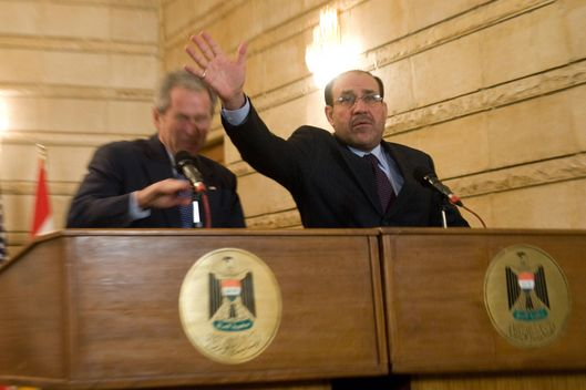 Iraq's Prime Minister Nuri al-Maliki tries to block US President George W. Bush after an Iraqi man threw his shoes at Bush during a joint press conference and signing ceremony at Maliki's private office during an unannounced visit to Baghdad, Iraq, on December 14, 2008. The trip marks Bush's fourth visit to the country during his presidency.