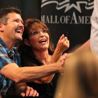 Todd Palin and Sarah Palin greet fans at the Best Buy Rotunda at Mall of America on June 29, 2011 in Bloomington, Minnesota.