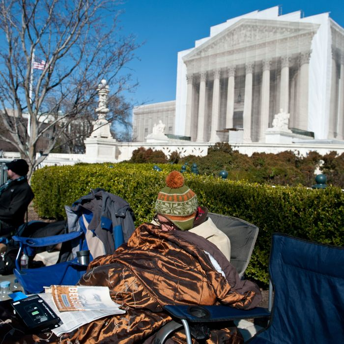 Paul Mazzuca rests in front of the Supreme Court in Washington on March 22, 2013 as people begin lining up for the court's upcoming coming hearings on gay marriage. The justices will hear arguments Tuesday on California's Proposition 8 ban on same-sex marriage and on Wednesday on the federal Defense of Marriage Act, which defines marriage as between one man and one woman.