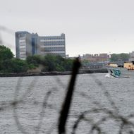 A view of buildings at the Rikers Island penitentiary complex where IMF head Dominique Strauss-Kahn is being held in New York on May 17, 2011. The grand jury deciding whether or not to send IMF chief Dominique Strauss-Kahn to trial has until May 20th to decide. In the meantime, Strauss-Kahn, accused of attempting to rape a hotel maid, remains incarcerated without bail because a judge deemed him liable to attempt escape to France, which does not extradite citizens to the United States.  AFP PHOTO/Emmanuel Dunand (Photo credit should read EMMANUEL DUNAND/AFP/Getty Images)
