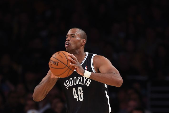 LOS ANGELES, CA - FEBRUARY 23:  Jason Collins #46 of the Brooklyn Nets handles the ball against the Los Angeles Lakers at Staples Center on February 23, 2014 in Los Angeles, California. NOTE TO USER: User expressly acknowledges and agrees that, by downloading and or using this photograph, User is consenting to the terms and conditions of the Getty Images License Agreement.  (Photo by Jeff Gross/Getty Images) *** Local Caption *** Jason Collins