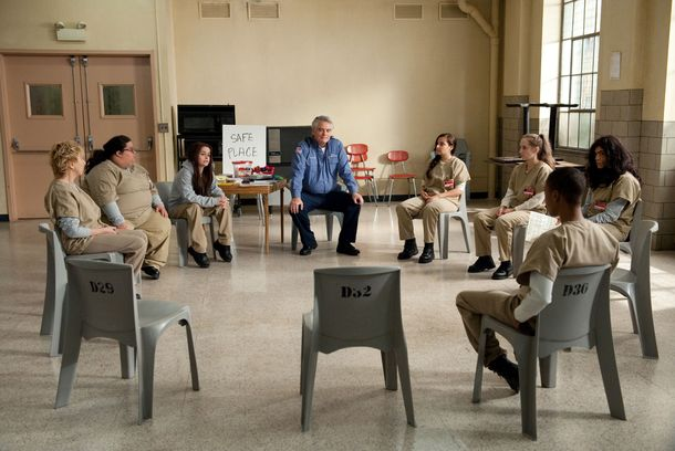 "Taryn Manning (center let) and Michael Harney (center right) in a scene from Netflix's ""Orange is the New Black"" Season 2. Photo credit: JoJo Whilden for Netflix."
