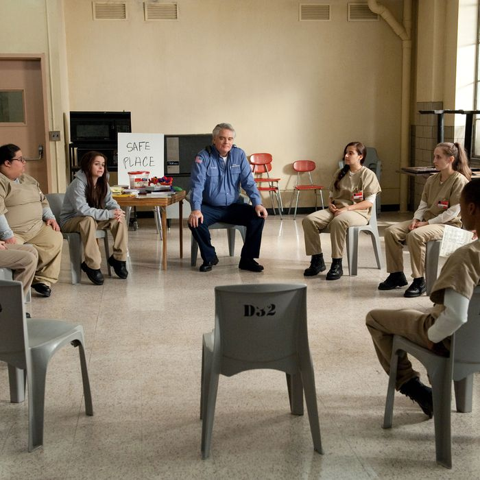 """Taryn Manning (center let) and Michael Harney (center right) in a scene from Netflix's """"Orange is the New Black"""" Season 2. Photo credit: JoJo Whilden for Netflix."""