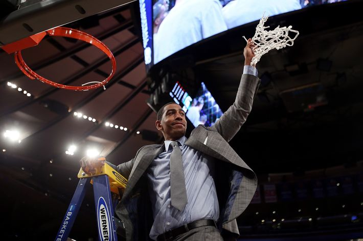 NEW YORK, NY - MARCH 30:  Head coach Kevin Ollie of the Connecticut Huskies cuts down the net after defeating the Michigan State Spartans to win the East Regional Final of the 2014 NCAA Men's Basketball Tournament at Madison Square Garden on March 30, 2014 in New York City.  (Photo by Bruce Bennett/Getty Images)