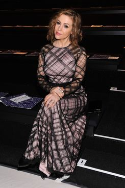 Actress, Alyssa Milano attends Tadashi Shoji fashion show during Mercedes-Benz Fashion Week Fall 2014 at The Salon at Lincoln Center on February 6, 2014 in New York City.