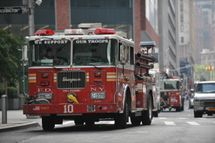 New York City Fire Department engines that responded to reports of a fire at the One World Trade Center tower drive down a street on August 8, 2012 in New York, that turned out to be a false alarm. Dozens of New York firefighters rushed to the World Trade Center skyscraper early Wednesday after a member of the public mistook welding for a fire. Initial reports from the New York Fire Department suggested a minor blaze on the 88th floor of One World Trade Center, the centerpiece in the project to replace the Twin Towers destroyed in the September 11, 2001 terrorist attacks. A spokesman told AFP the fire was brought under control in less than an hour.