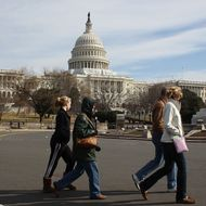 Tourists walk past the U.S. Capitol building, on February 17, 2012 in Washington, DC. Earlier today the FBI arrested a man with possible ties to al-Qaeda, for plotting to blow up the U.S. Capitol building in an apparent suicide attack.