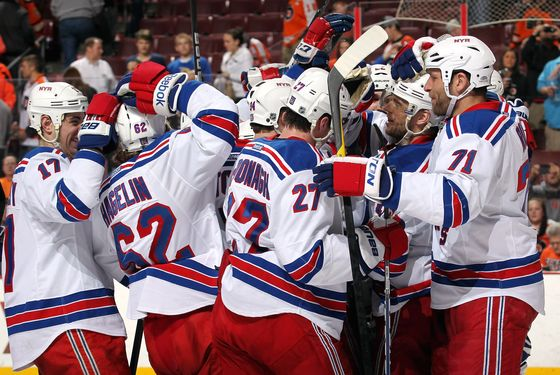 PHILADELPHIA, PA - APRIL 03: Members of the New York Rangers celebrate after defeating the Philadelphia Flyers 5-3 on April 3, 2012 at the Wells Fargo Center in Philadelphia, Pennsylvania.  (Photo by Len Redkoles/NHLI via Getty Images)