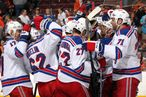 Members of the New York Rangers celebrate after defeating the Philadelphia Flyers 5-3 on April 3, 2012 at the Wells Fargo Center in Philadelphia, Pennsylvania.