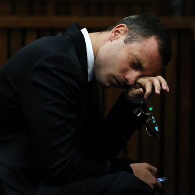 South African Paralympic track star Oscar Pistorius reacts during his trial for the murder of his girlfriend Reeva Steenkamp, at the North Gauteng High Court in Pretoria, on April 7, 2014. An emotional Oscar Pistorius took the stand as a witness in his defence on April 7, fighting through tears to apologise to the family of his girlfriend Reeva Steenkamp for killing her on Valentine's Day 2013.