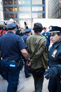 NEW YORK -- SEPTEMBER 19: A protester is arrested on Broadway in front of Zuccotti Park, where demonstrators protesting  against the financial system are gathering on September 19, 2011 in New York City. Organizers said the protests, which began Saturday, could last for weeks. (Photo by Michael Nagle/Getty Images)