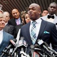 "Defense attorney Rusty Hardin, (L) and NFL running back Adrian Peterson of the of the Minnesota Vikings address the media after Peterson plead ""no contest"" to a lesser misdemeanor charge of reckless assault on November 4, 2014 in Conroe, Texas. Peterson's plea to the Class A misdemeanor comes with two years of deferred adjudication. Peterson also received a $4,000 fine and 80 hours of required community service.  (Photo by Bob Levey/Getty Images)"