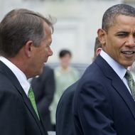US President Barack Obama and Speaker of the House John Boehner (L) speak following a St. Patrick's Day Luncheon at the US Capitol in Washington, DC, March 20, 2012.