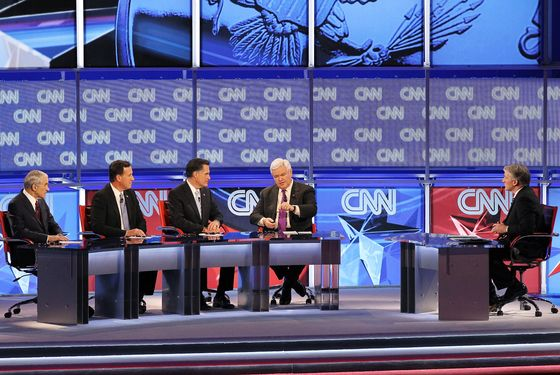 MESA, AZ - FEBRUARY 22:  (L-R) Republican presidential candidates U.S. Rep. Ron Paul (R-TX), former U.S. Sen. Rick Santorum, former Massachusetts Gov. Mitt Romney and former Speaker of the House Newt Gingrich participate in a debate sponsored by CNN and the Republican Party of Arizona as CNN's John King moderates at the Mesa Arts Center February 22, 2012 in Mesa, Arizona. The debate is the last one scheduled before voters head to the polls in Michigan and Arizona's primaries on February 28 and Super Tuesday on March 6.  (Photo by Justin Sullivan/Getty Images)