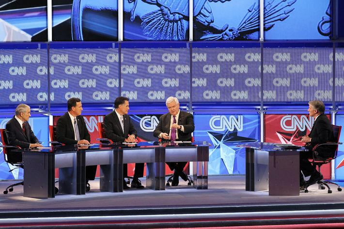 (L-R) Republican presidential candidates U.S. Rep. Ron Paul (R-TX), former U.S. Sen. Rick Santorum, former Massachusetts Gov. Mitt Romney and former Speaker of the House Newt Gingrich participate in a debate sponsored by CNN and the Republican Party of Arizona