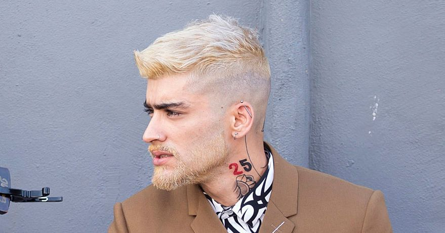 EXCLUSIVE: Zayn Malik shows off his latest head tattoos and new blonde hair and beard during a video shoot in Miami, Florida.