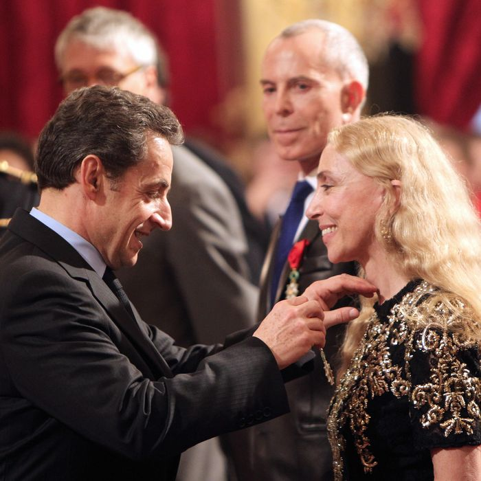 Nicolas Sarkozy awards Franca Sozzani the Legion of Honor.