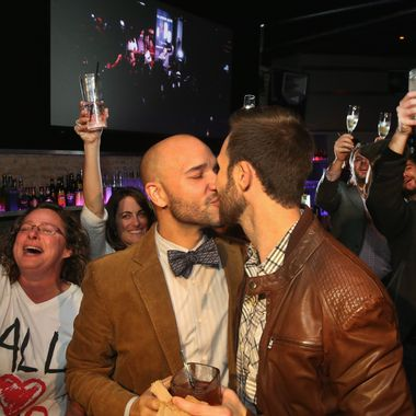 CHICAGO, IL - NOVEMBER 05:  Fernando Mojica (L) celebrates with Drew Freeman at the Side Track bar after the Illinois General Assembly approved a gay marriage bill on November 5, 2013 in Chicago, Illinois. The governor has said he will sign the bill which will make Illinois the 15th state to legalize same-sex unions. (Photo by Scott Olson/Getty Images)