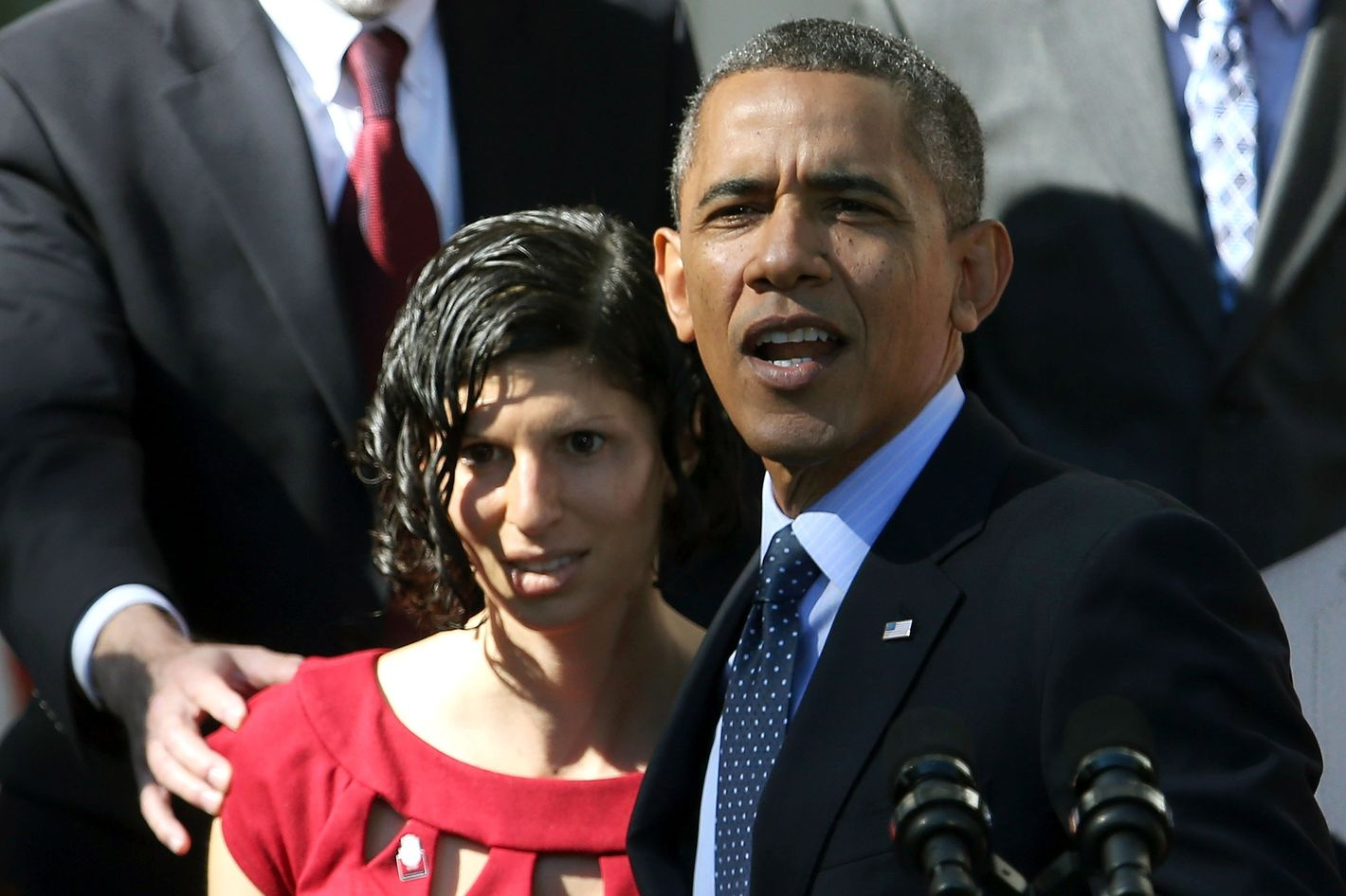 WASHINGTON, DC - OCTOBER 21: U.S. President Barack Obama holds onto Karmel Allison who has Type 1 Diabetes and felt light headed while he was delivering remarks about the error-plagued launch of the Affordable Care Act's online enrollment website in the Rose Garden of the White House October 21, 2013 in Washington, DC. According to the White House, the president was joined by 'consumers, small business owners, and pharmacists who have either benefitted from the health care law already or are helping consumers learn about what the law means for them and how they can get covered. 'Despite the new health care law's website problems, Obama urged Americans not to be deterred from registering for Obamacare because of the technological problems that have plagued its rollout.  (Photo by Mark Wilson/Getty Images)