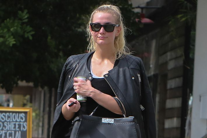 Ashlee Simpson exiting the gym.