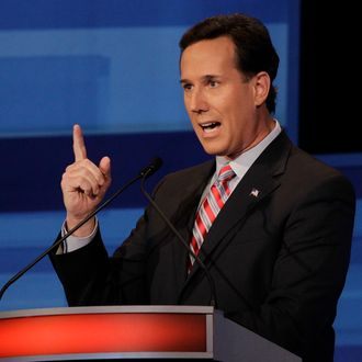 Republican presidential candidate, former Pennsylvania Sen. Rick Santorum, participates in a presidential debate in Sioux City, Iowa, Thursday, December 15, 2011. AFP PHOTO / Pool / Eric Gay (Photo credit should read ERIC GAY/AFP/Getty Images)